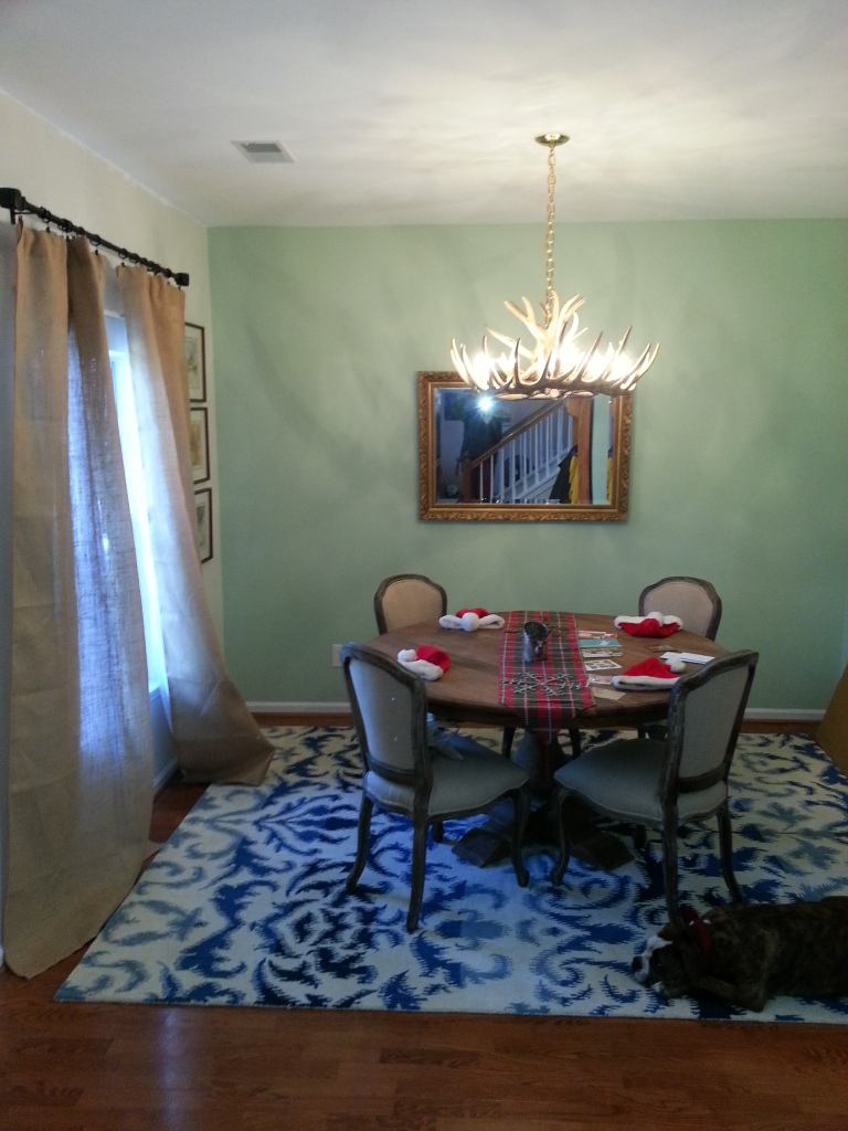 We painted the walls, added curtains, installed an antler chandelier and bought a rustic circular farm table.